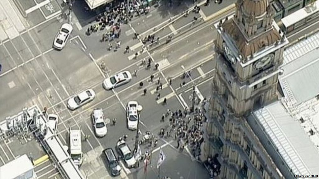 Car ploughs into pedestrians in Melbourne, killing three people and in...