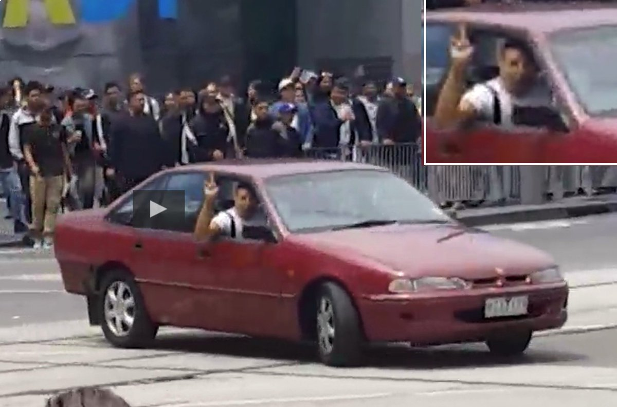 Scenes from Melbourne attacker, blocking traffic, pointing finger (several times)