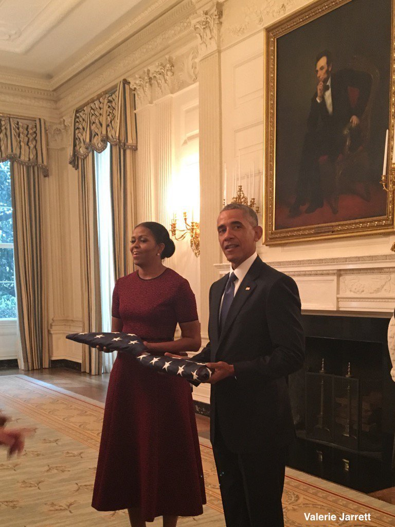 President Obama and First Lady Michelle Obama presented with flags that flew over White House on first and last day of presidency.