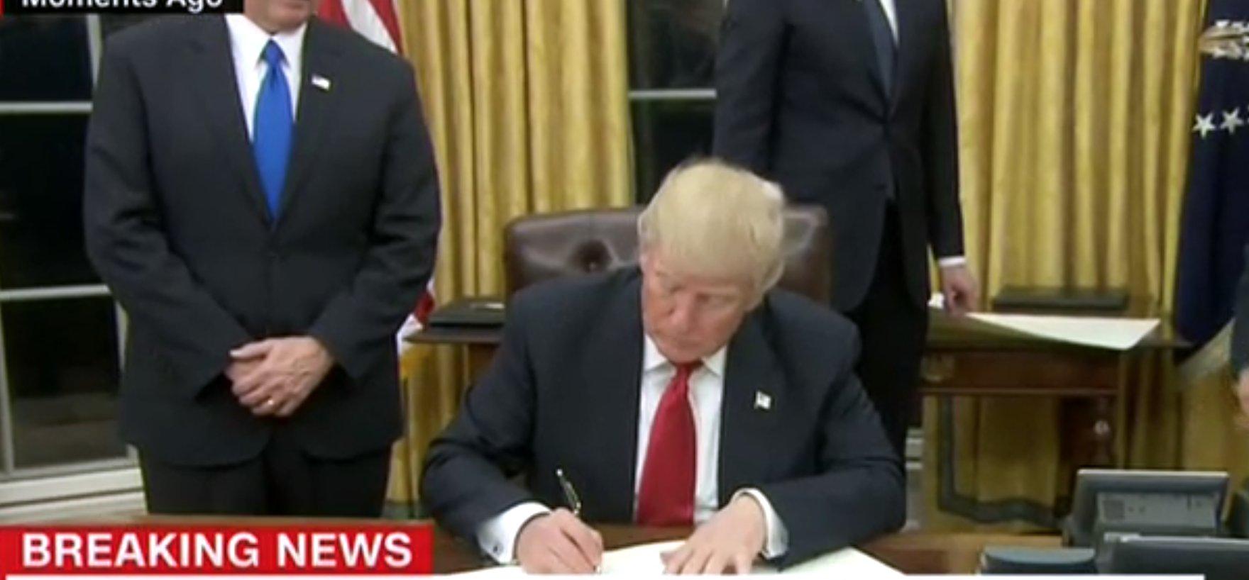 trump signs executive order ease burden obamacare