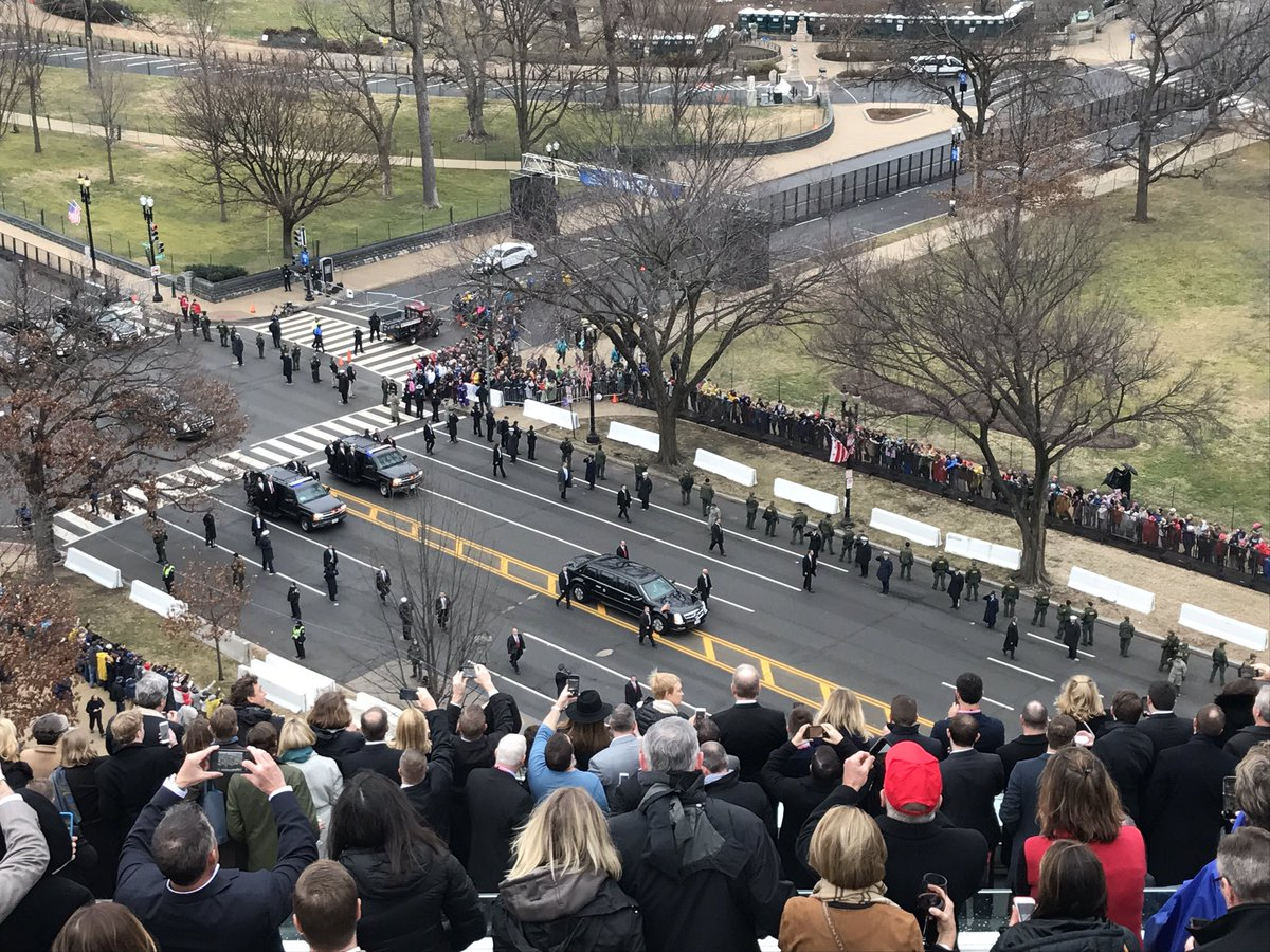 We could see @POTUS waving through the window- he's in the car surroun...