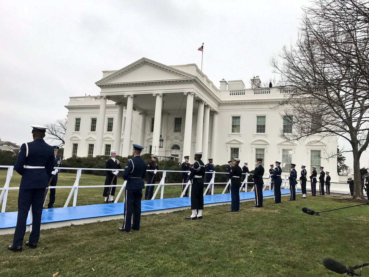 Military honor guard awaiting President Trump on WH North Lawn #Inaugu...