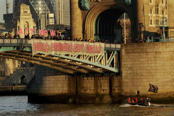 Trump Protest Banners pinned on London Bridges and even in Watford