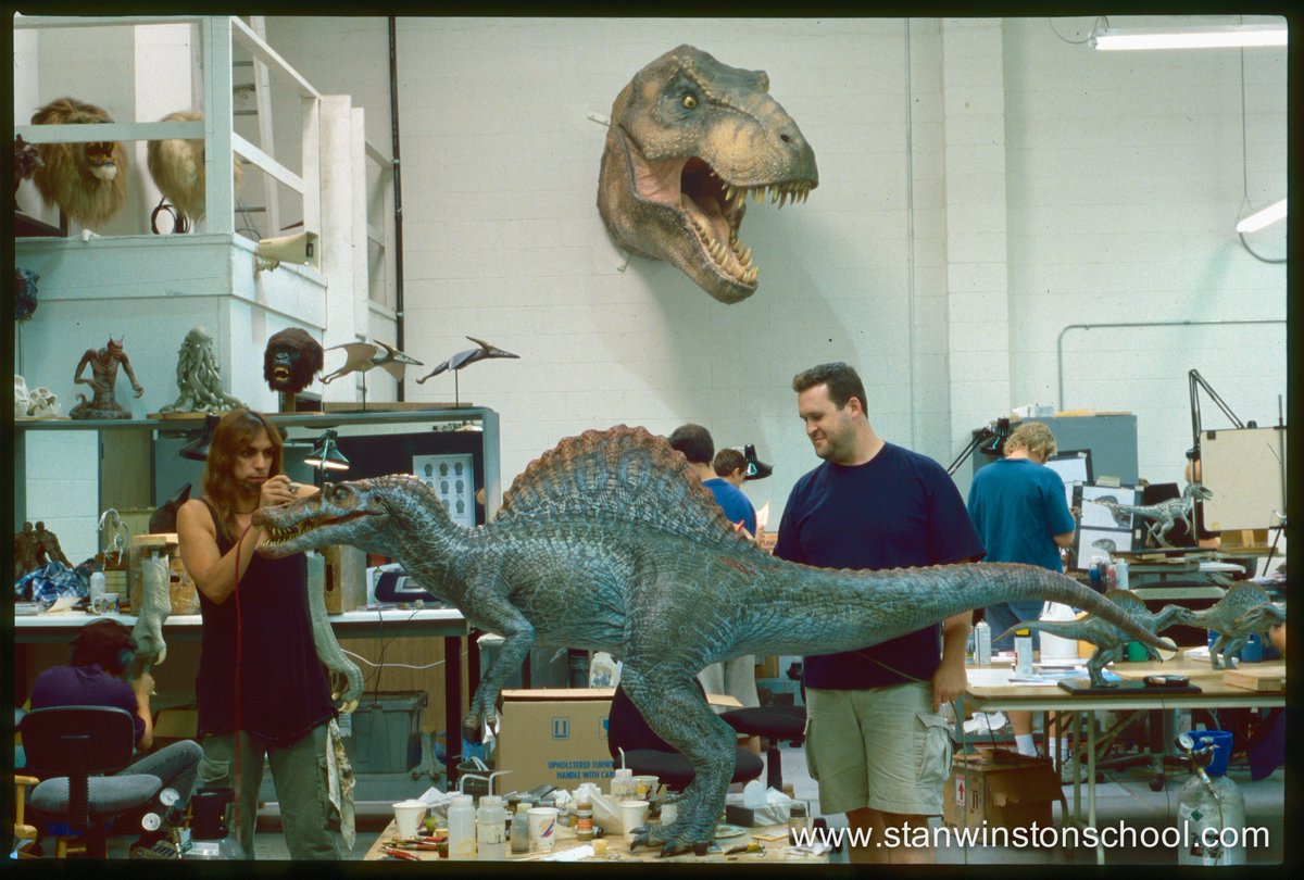 Joey Orosco and Trevor L. Hensley paint the 1/5 scale Spinosaurus mode...