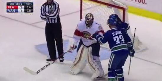 .@strombone1 congratulates Henrik Sedin after recording 1,000th career...