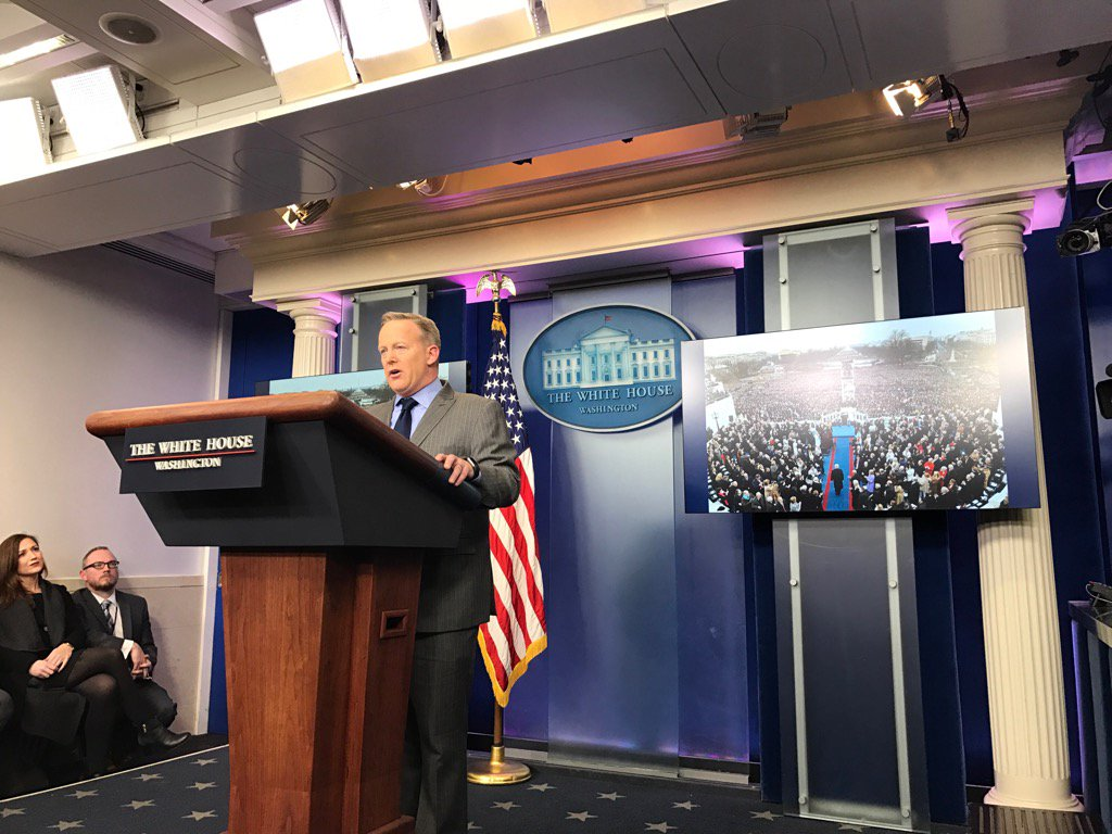 Spicer in his first remarks from WH briefing room complaining about news coverage, inauguration pics behind him