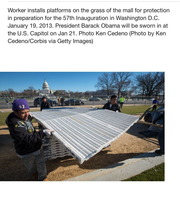 Pic of crews laying down white ground coverings at Obama inaugural in 2013 courtesy Getty images