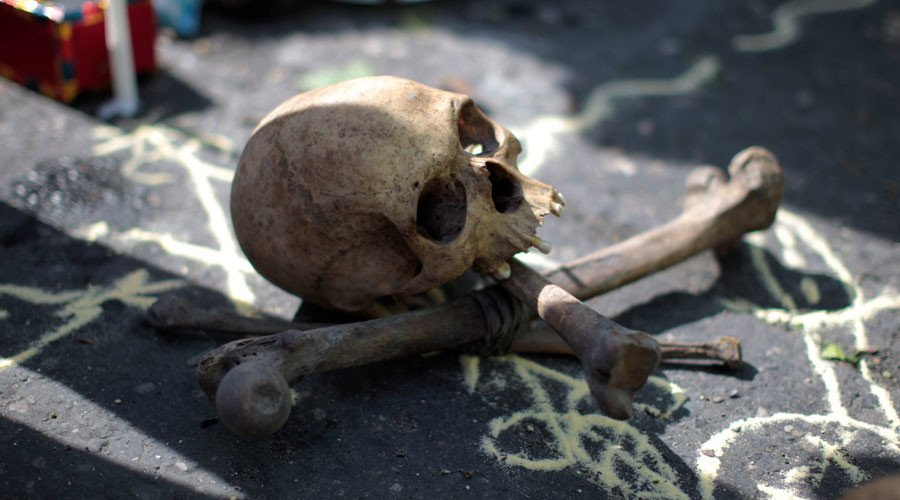 Grave robbers dig up skeletons, scatter bones around Manchester cemete...