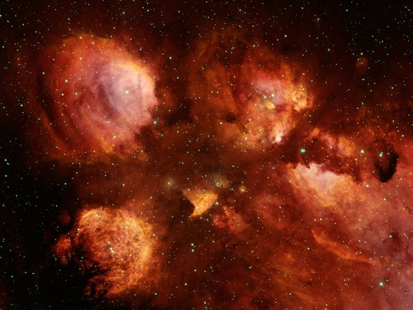 The cat\'s paw nebula is home to multiple young stars, each at least 10 times as large as our Sun!
