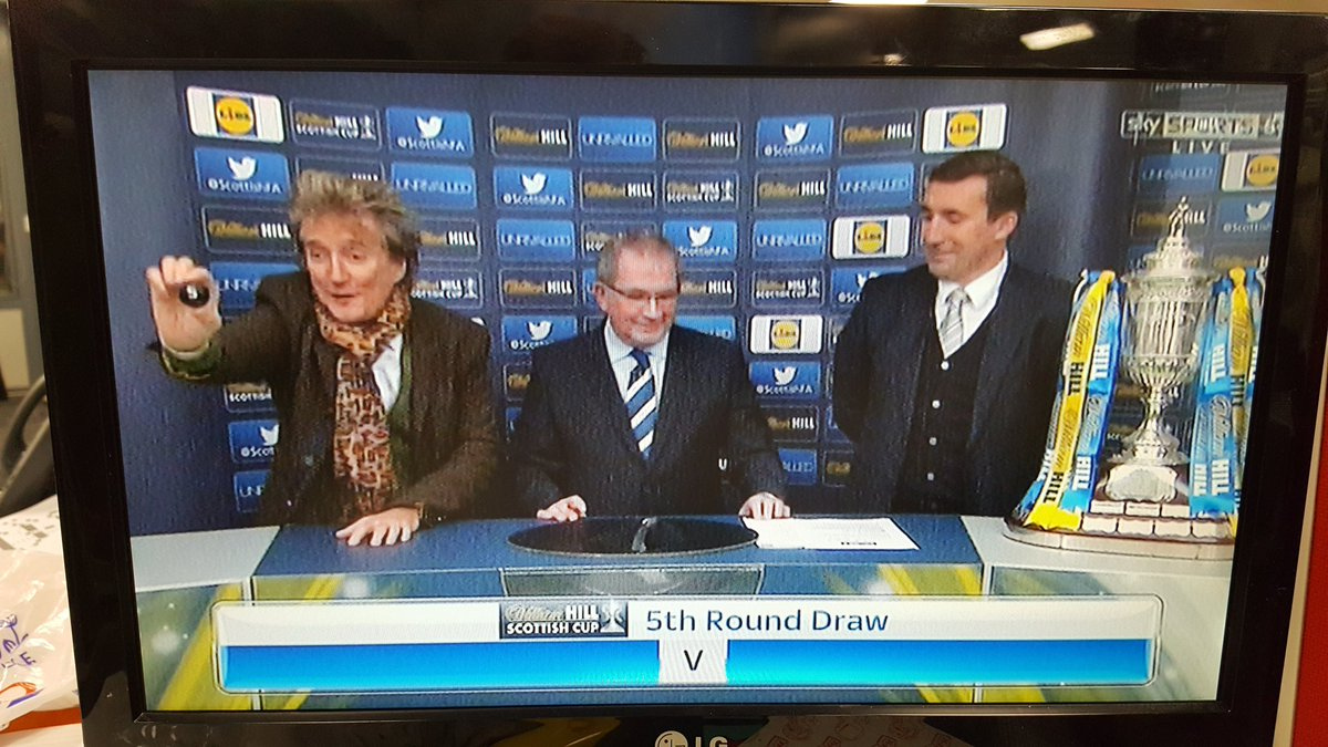 Rod Stewart doing the Scottish Cup draw several sheets to the wind. ht...