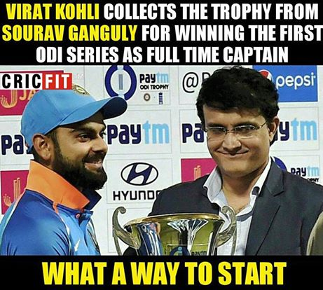 Virat Kohli collects the trophy from Sourav Ganguly
