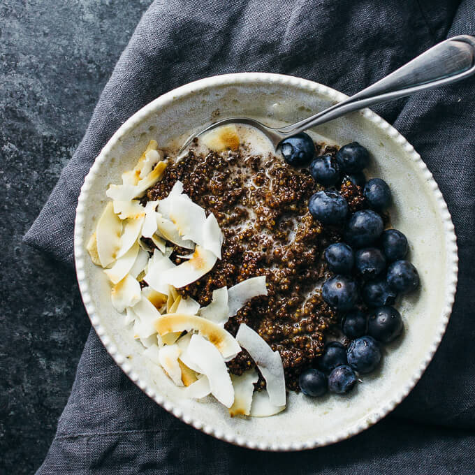 Chocolate quinoa breakfast bowl with coconut and blueberries