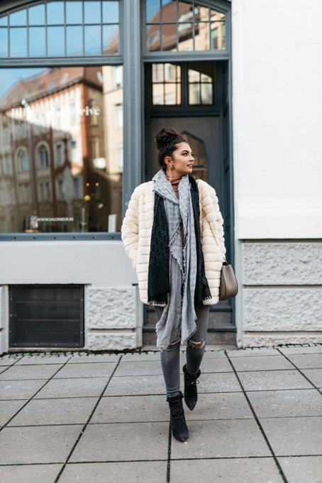cozy coat with grey ripped jeans