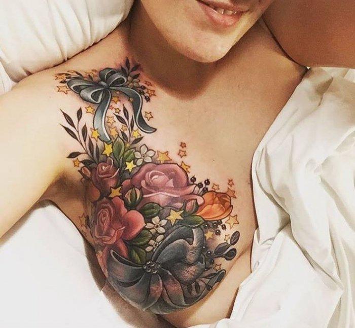 Girl breast tattoo