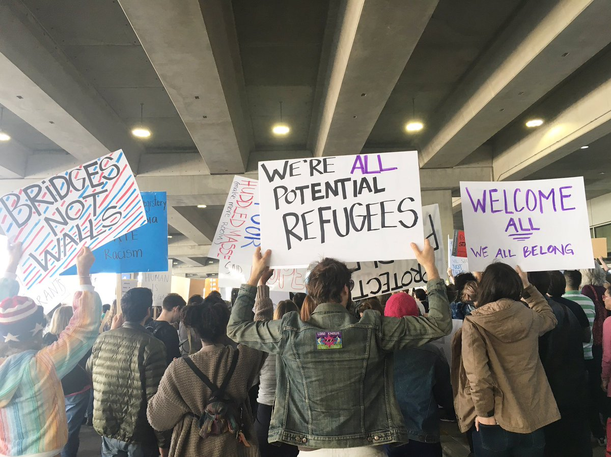 Several hundred people are gathered at @AUStinAirport protesting Trump's refugee ban. #RefugeesWelcome https://t.co/dQZtwgC7QD