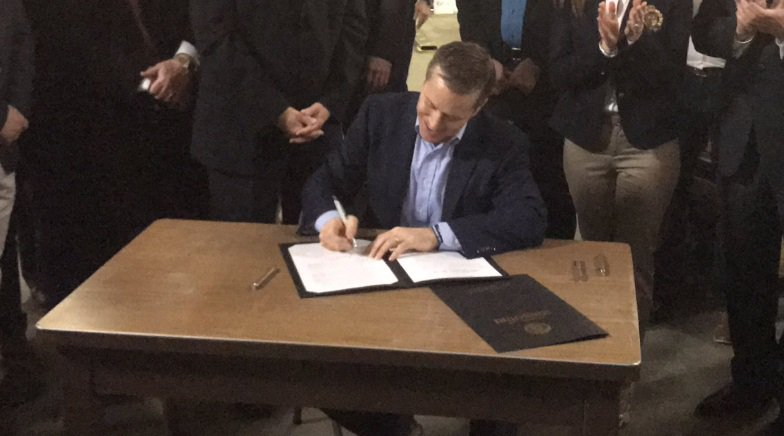 GOP Governor @EricGreitens signs #RightToWork into law, making Missour...