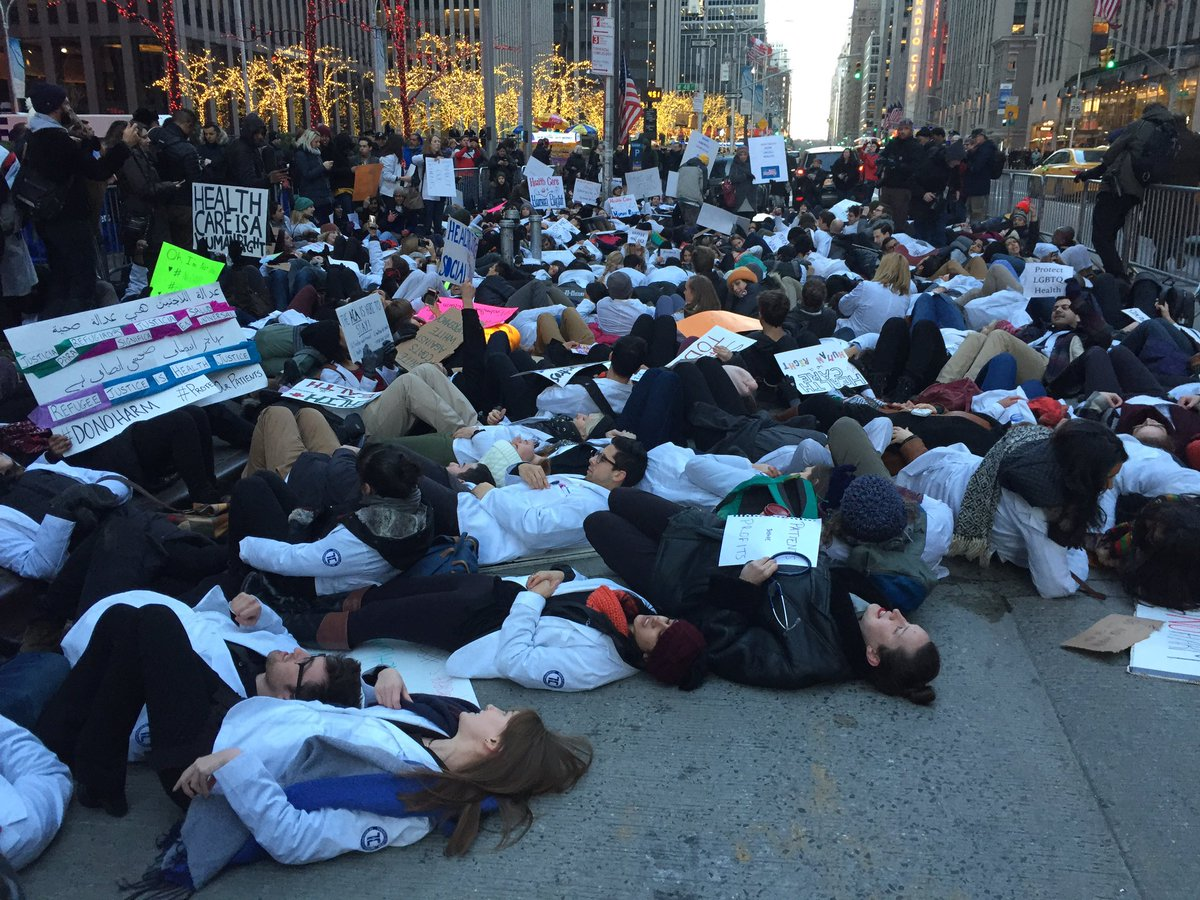 Happening now: Medical students stage die-in outside @FoxNews in NYC protesting the repeal of the Affordable Care Act