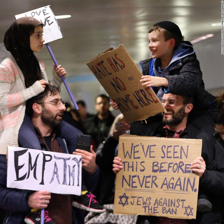 This photo of a Muslim girl and Jewish boy rallying for the same cause with their dads has warmed the hearts of many https://t.co/prjZ2MG4FM