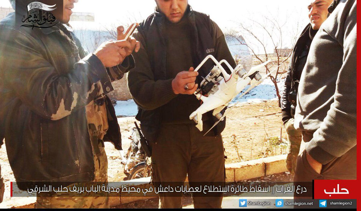 Faylaq Al-Sham fighters in Al-Bab area showing a downed ISIS quadcopter drone (Dji Dhantom model)  and  ACV-15