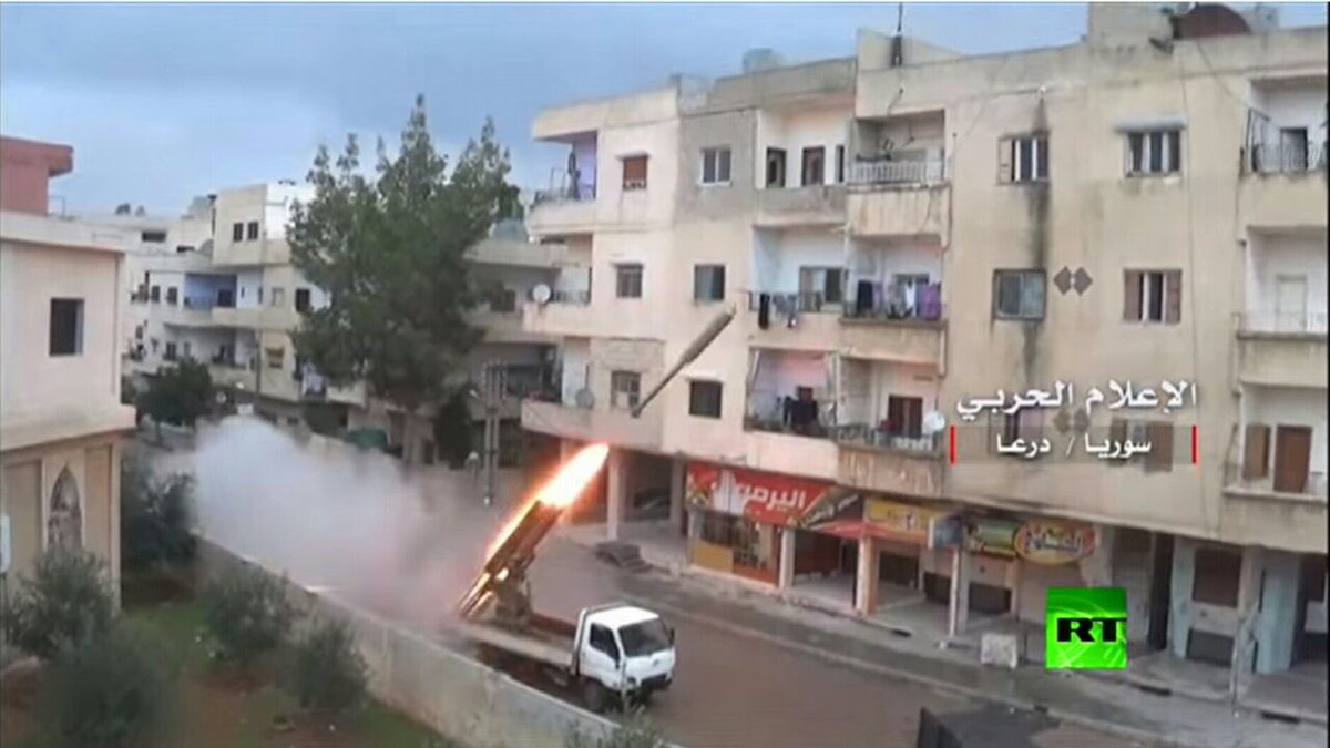Daraa: Russia Today footage of government forces firing Grad missiles from civilian areas, using civilian areas as human shields