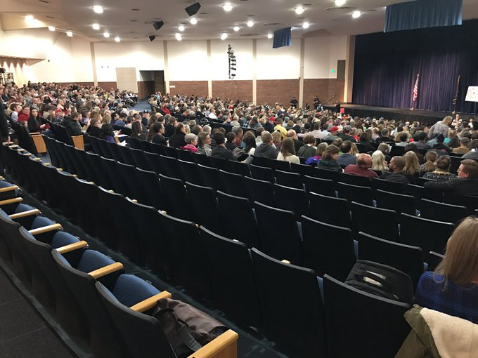At th #Chaffetze  town hall, loud boos inside that hundreds of protesters outside aren't allowed to fill these back seats: