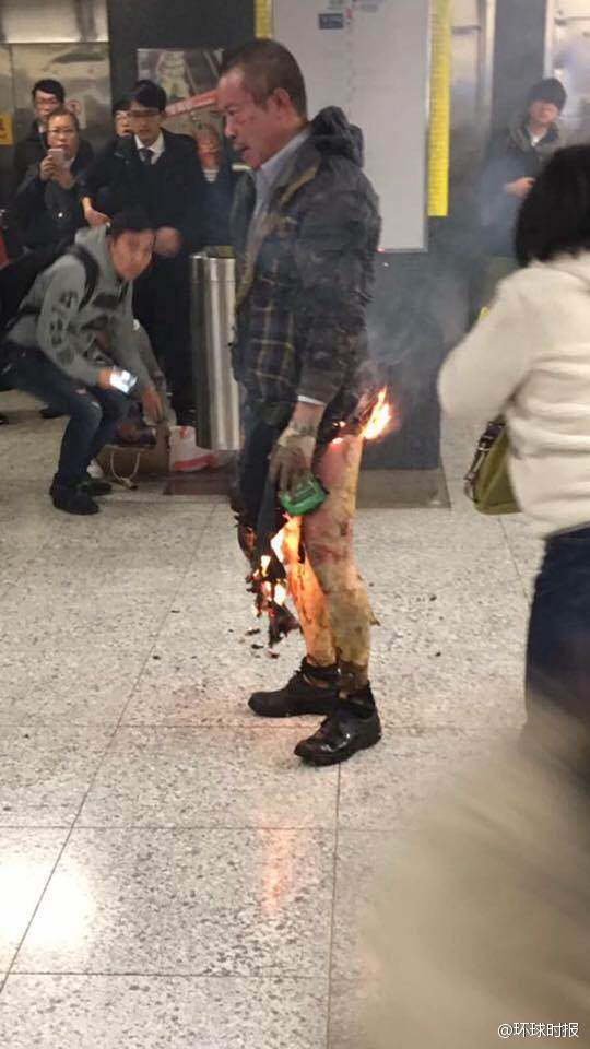 At least 13 injured after train at Tsim Sha Tsui MTR station in HongK ong caught fire. Report said a man tried to hurl a petrol bomb