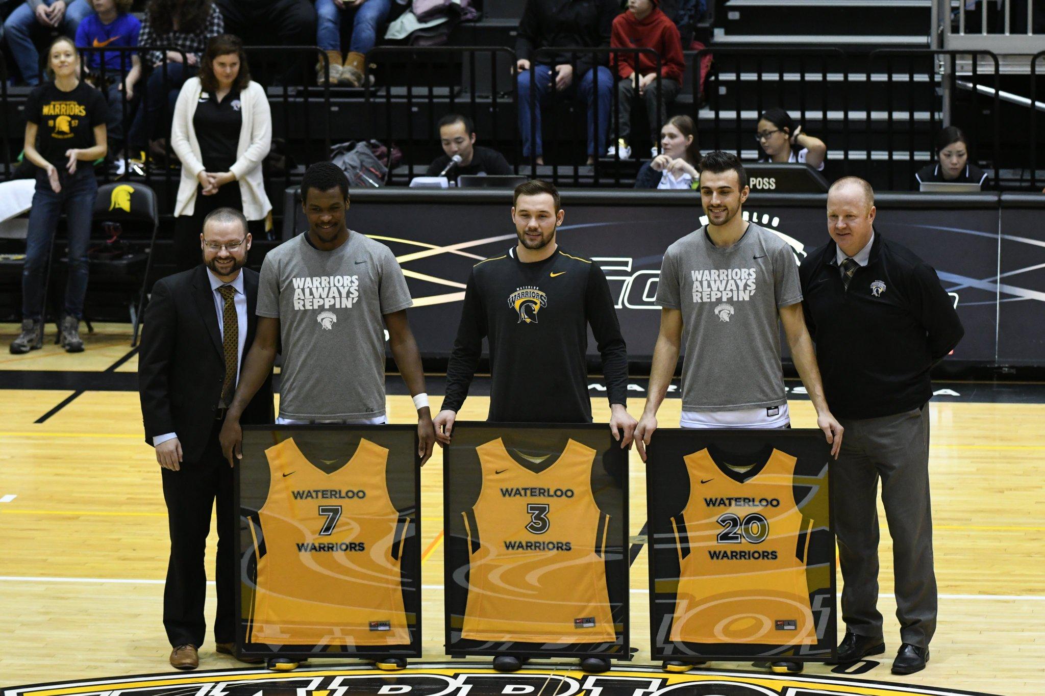Seniors honoured at #UWaterlooFAD @WlooWarriors mens basketball game.  #7 Ben Davis, #3 Jon Ravenhorst, and #20 Mike Pereira. https://t.co/coDxxA6mhg
