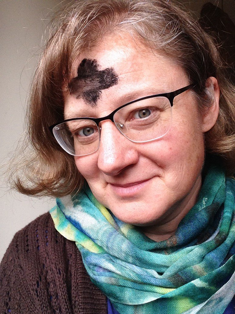 Jen with massive black ashen cross on her forehead.