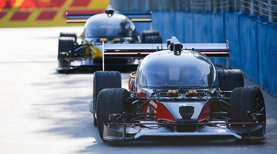 Self-driving robot cars reach 115 mph on racing debuts (PHOTOS, VIDEOS...