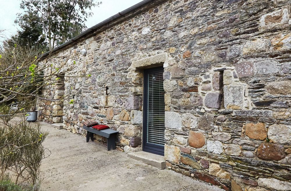 Two tumbledown ancient barns have been transformed into a beautiful mo...