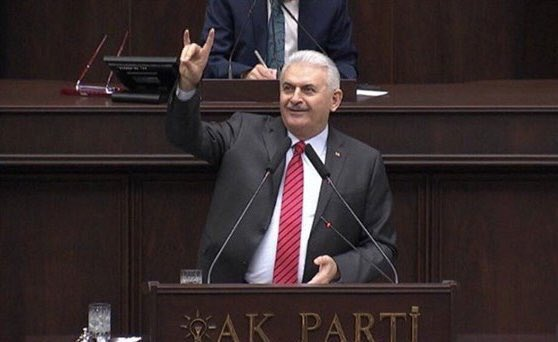 While PM #Yildirim making fascistic sign of Grey Wolves during parl session his soldiers making same sign after torturing &amp; killing #Kurds! <br>http://pic.twitter.com/YTKhdYexaX
