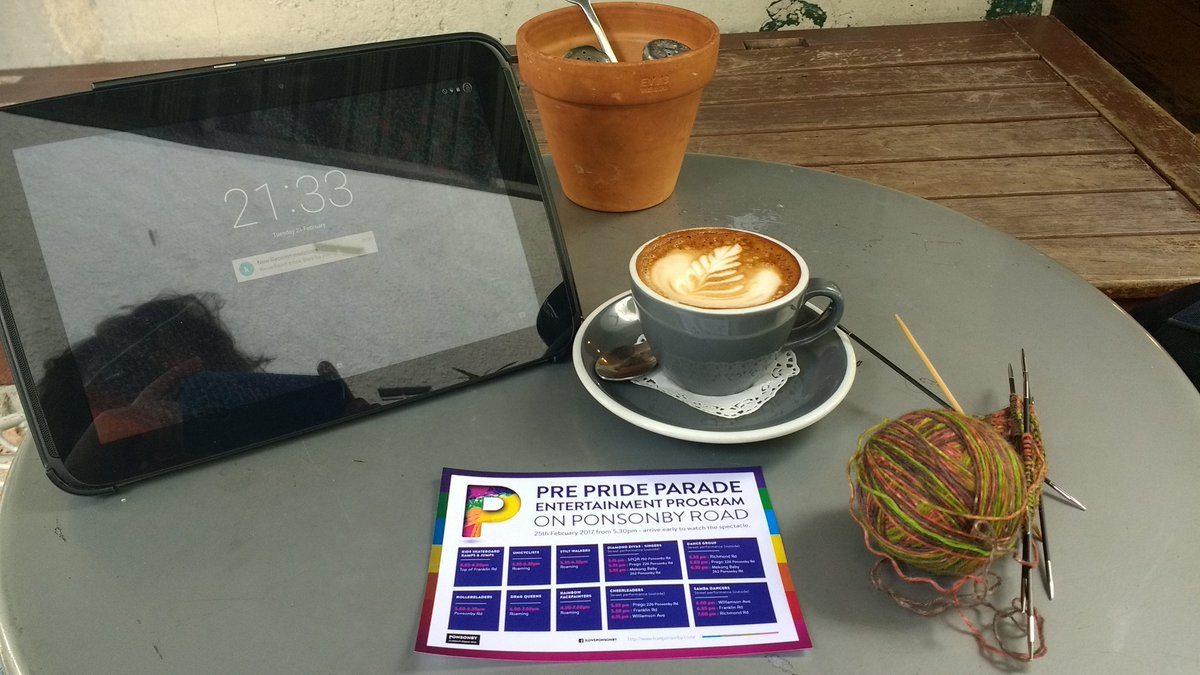 Pride information with coffee and knitting.