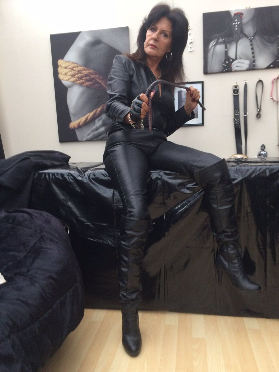 image She loves leather gloves boots and sucking for cum