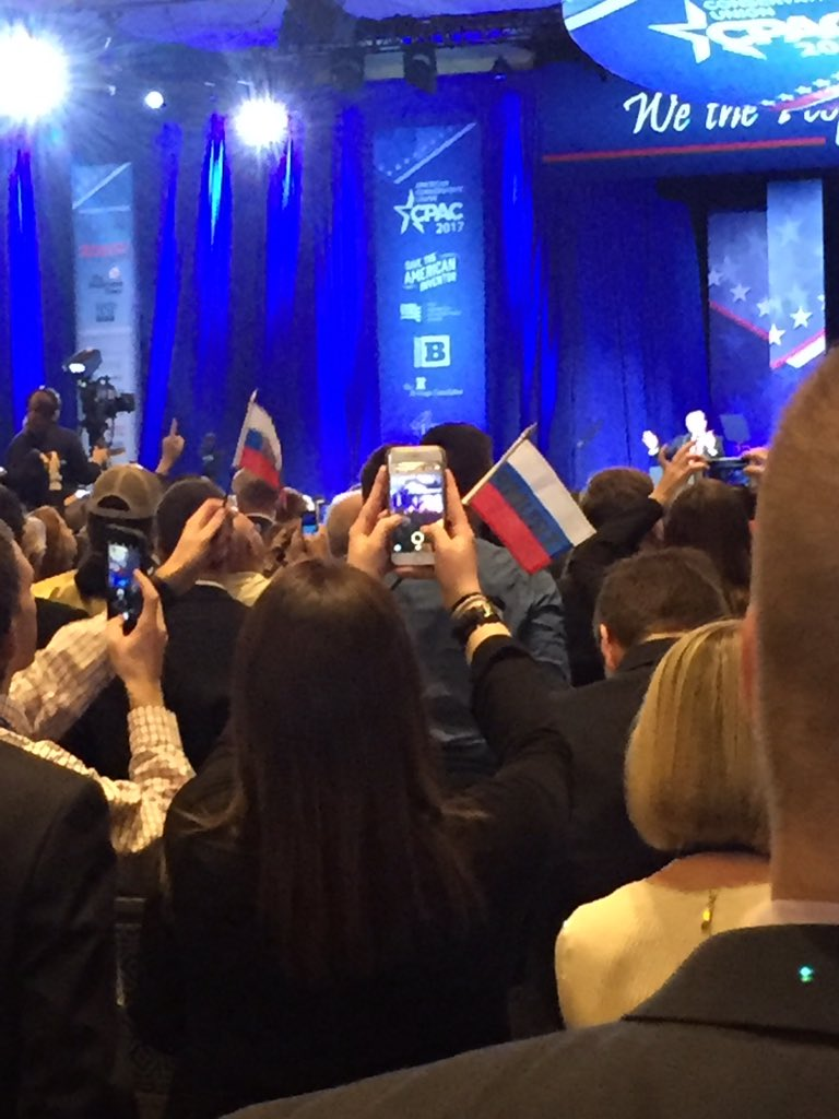 Crowd at CPAC waving these little pro-Trump flags that look exactly like the Russian flag. Staffers quickly come around to confiscate them.
