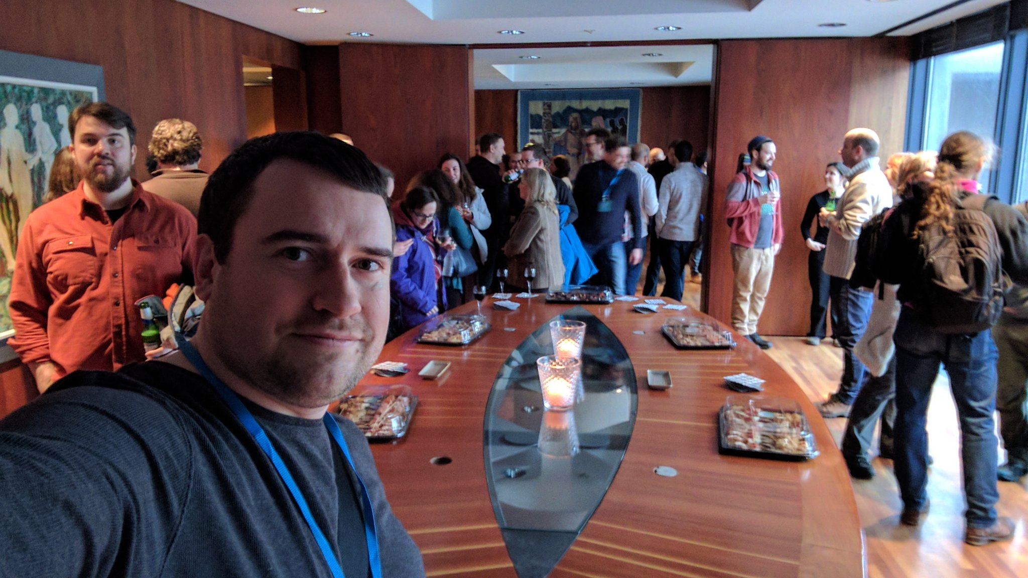 group of drupal developers around a large table, it is a selfie pic