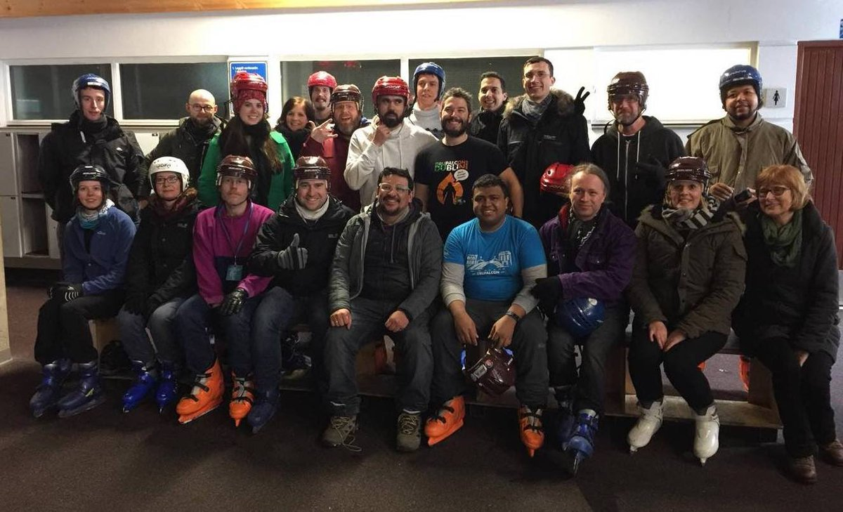 23 people dressed for ice skating. half of them are sitting down