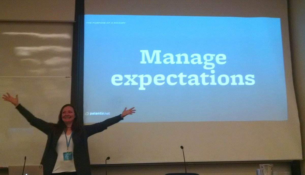 Alison Manley in front of a screen that says Manage Expectations
