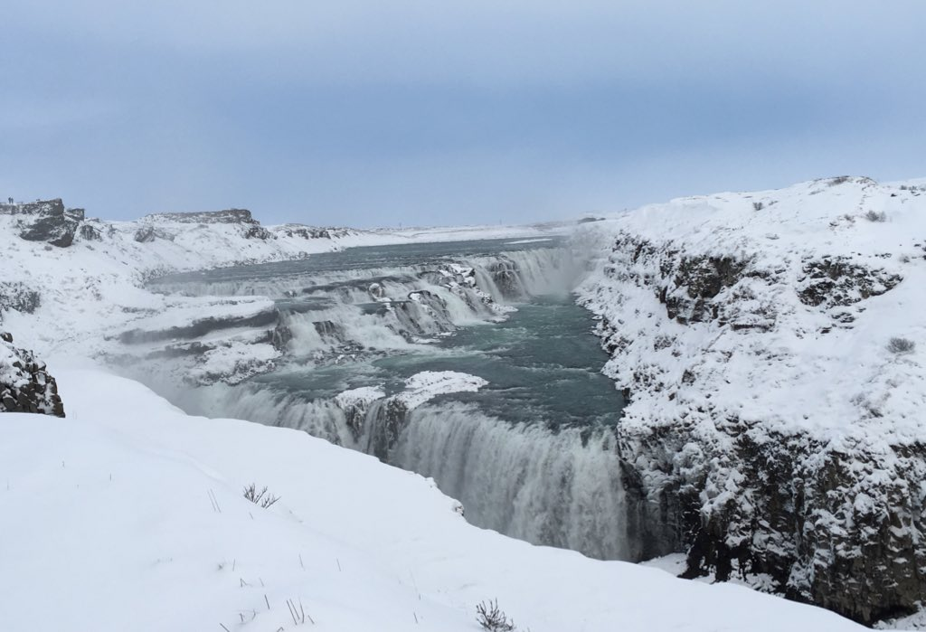 Gullfoss waterfall, large powerful river guching waterfall over cliff
