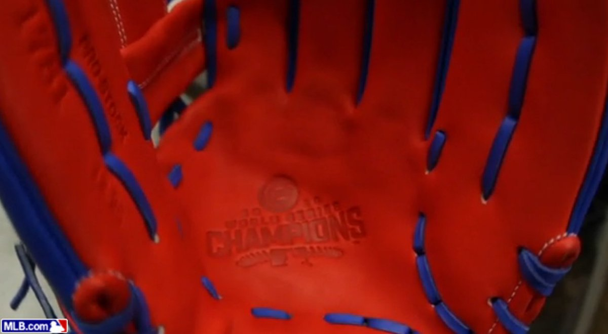 Championship swag.  Cubs receive custom gloves in honor of World Serie...