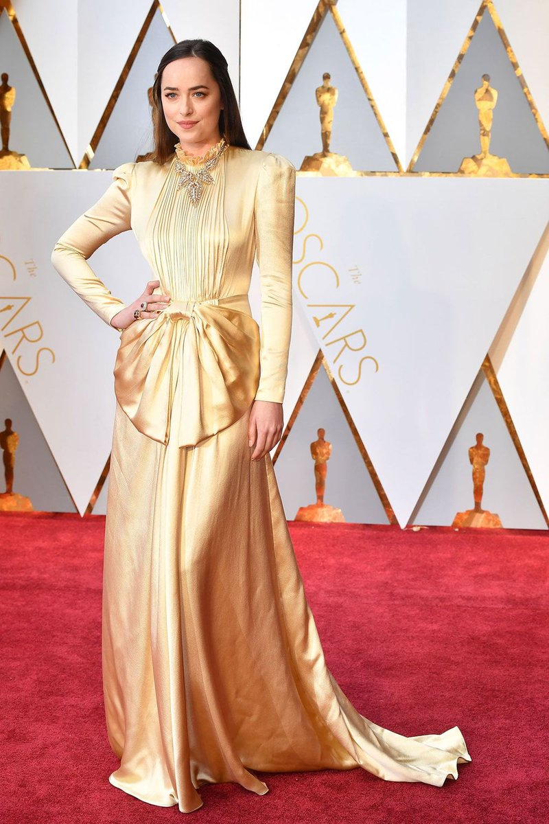 Dakota Johnson glistens in @Gucci: https://t.co/CFISK5svpI  #Oscars ht...