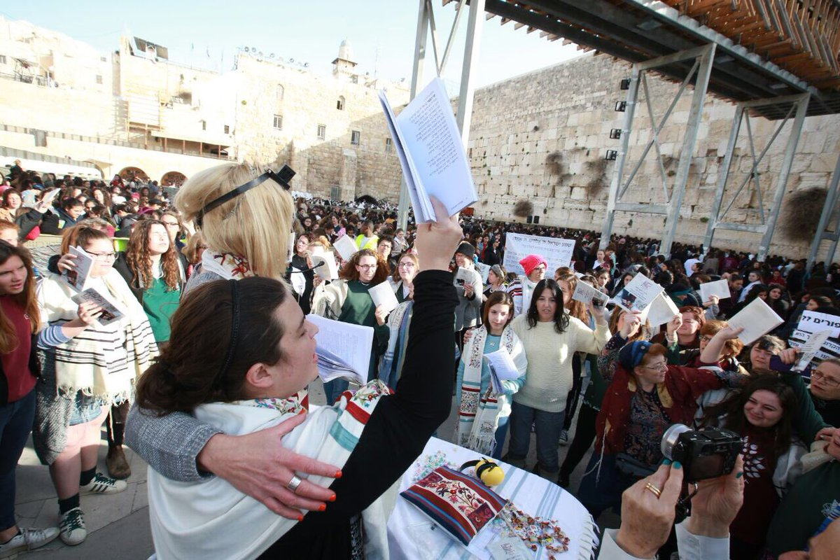 More than 150 women praying at Kotel despite the jostling, the slurs, the caged-in zone, the whistles & the yelling. https://t.co/TnifwQoXsy