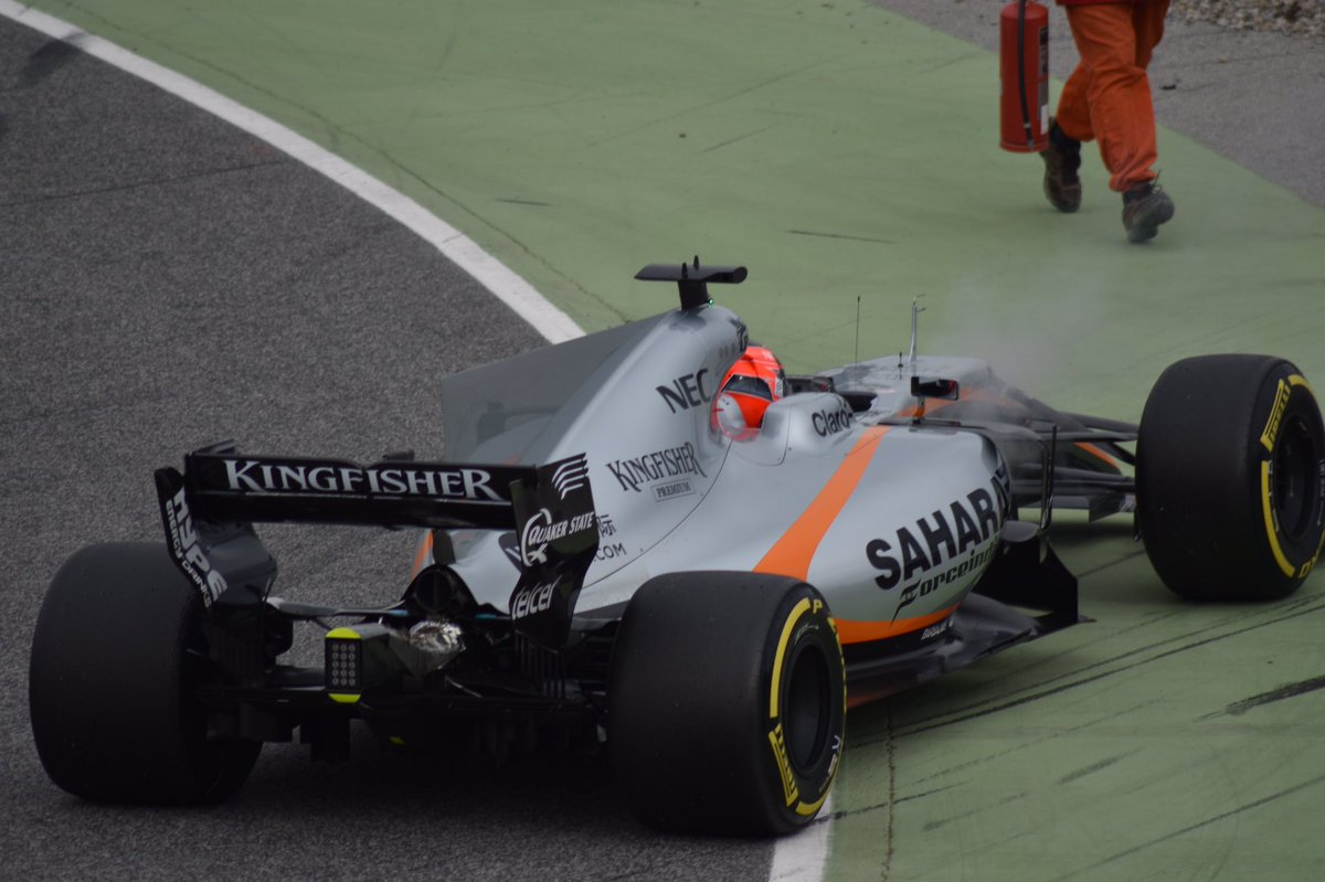 This is a photo took by Adaco in F1 tests at Barcellona. Here Ocon stops his Force India VJM10, causing a red flag.