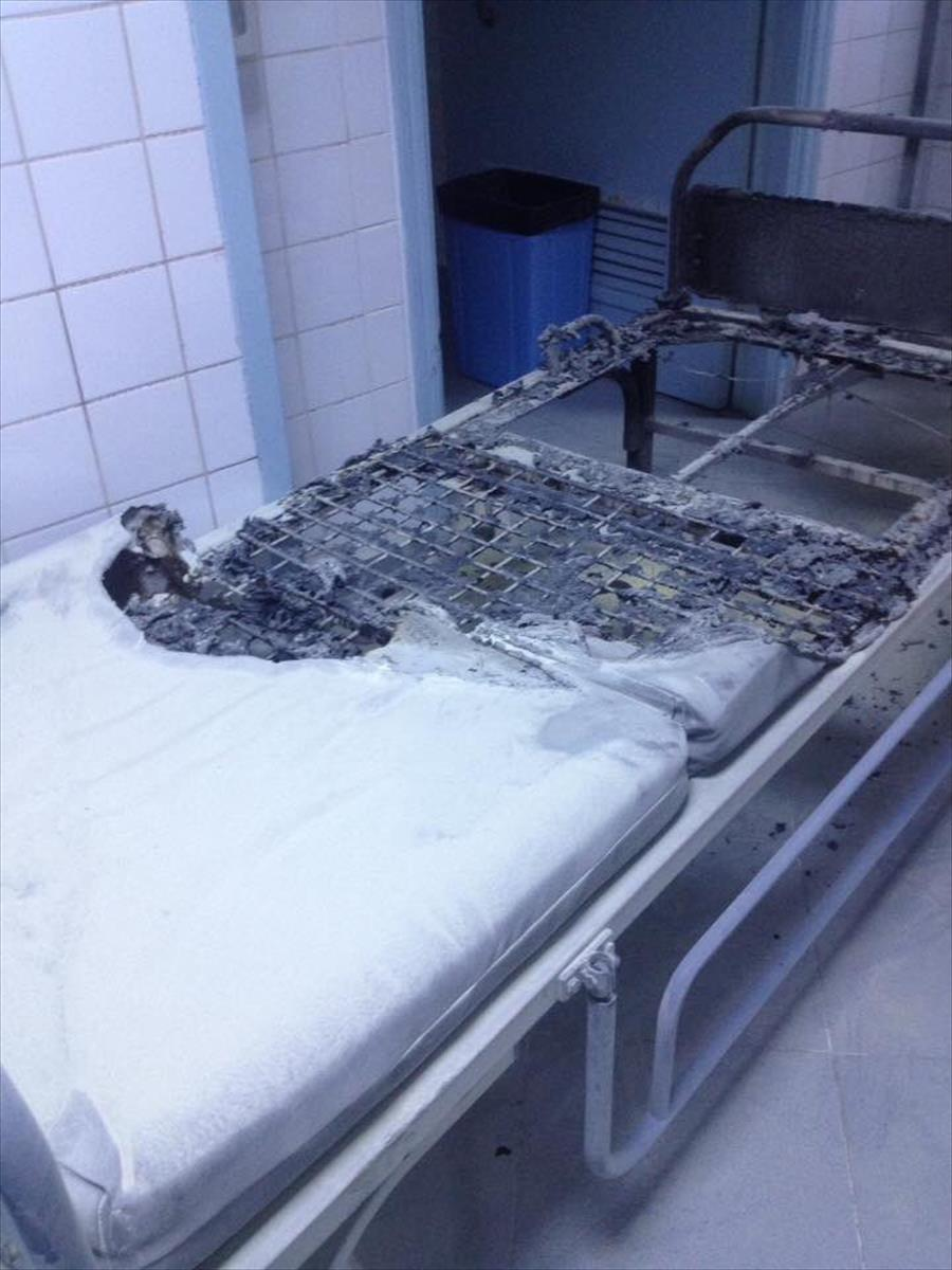 Damage caused to the children's unit at al-Khadraa hospital's in Tripoli after being hit by a shell during clashes