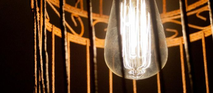 DIY Pendant Light: Bright New Life for a Rusty Birdcage