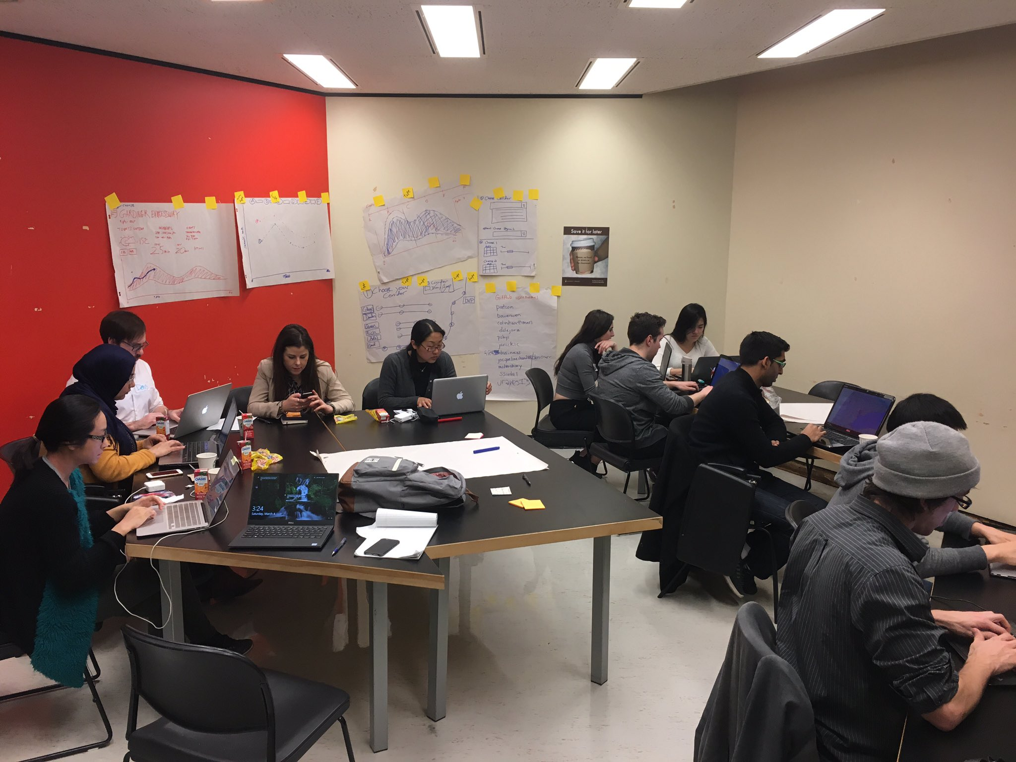 Great multi-talented team hard at work on the transportation challenge #CodeAcrossTO https://t.co/sgJLW5cA5H