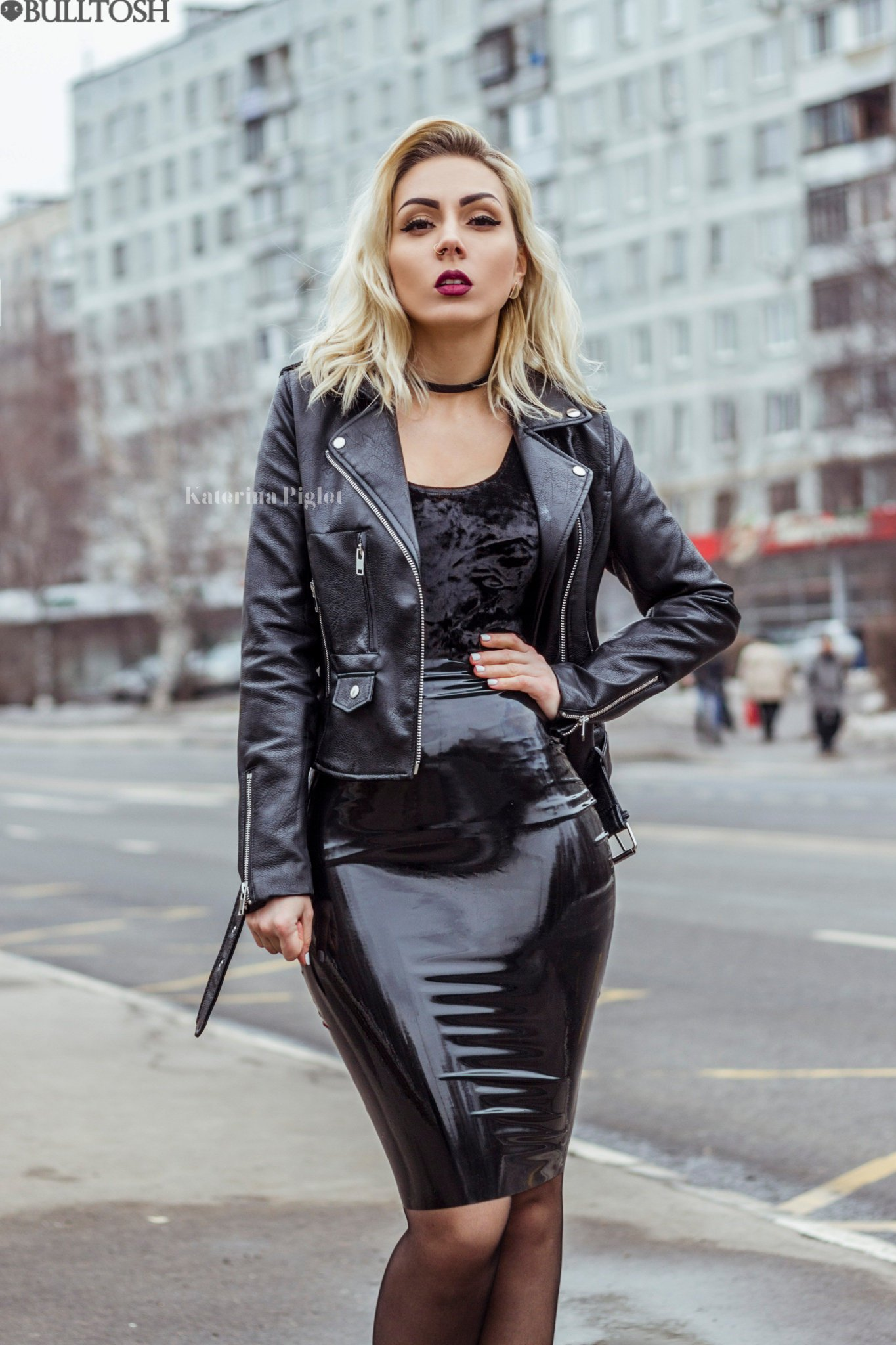 Blonde woman wearing shiny leather pants and high heel boots 10