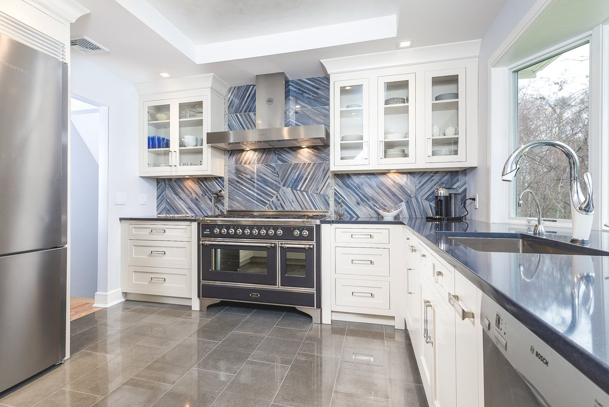 Artistic tile on twitter kauri in tasman blue is a stunning artistic tile on twitter kauri in tasman blue is a stunning backsplash choice especially when paired with ivory colored cabinets dailygadgetfo Images