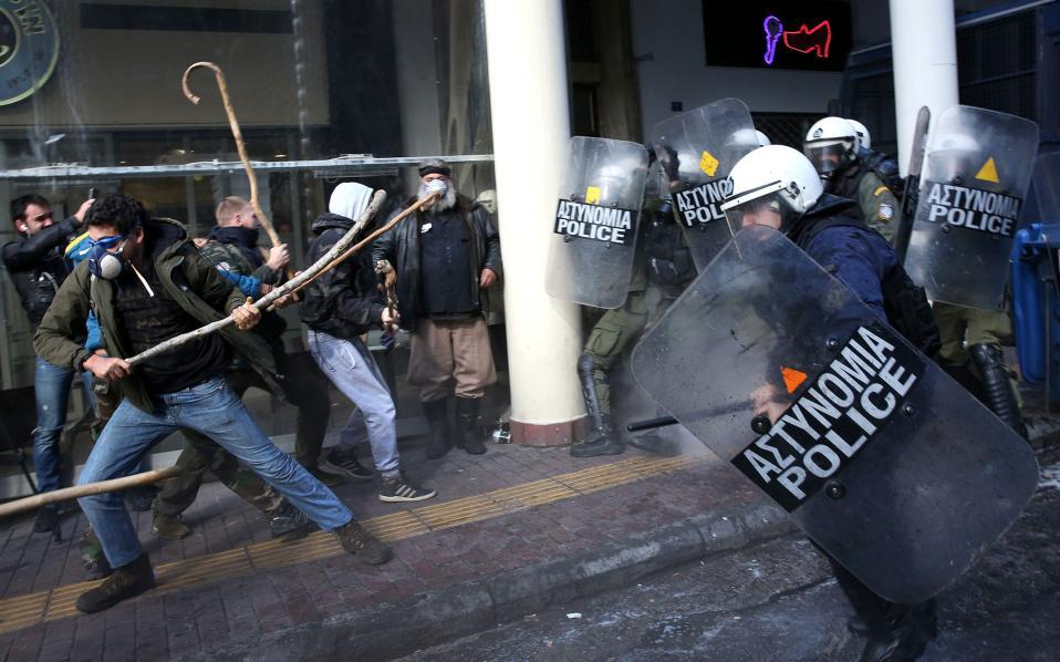 Greek farmers protesting tax hikes fight police in Athens https://t.co/Le7fnfag4x https://t.co/FWvwZCDQAl