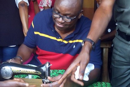 Governor Ayodele Fayose doing justice to one of the Ankara cloth chosen ahead of the world women's day celebration coming up on the 8th of March, 2017.