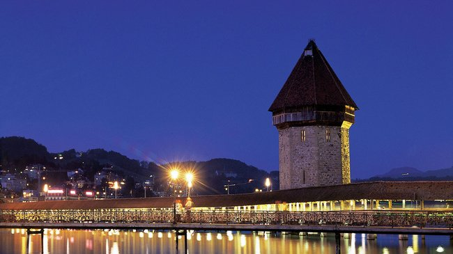 Lucerne's Chapel Bridge is the world's oldest covered wooden bridge an...
